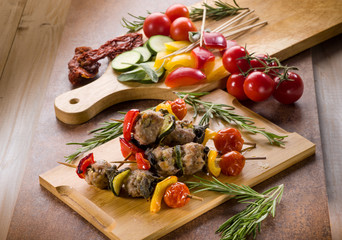 skewer with meat balls and vegetables