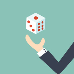 Business risk concept - businessman throwing dice