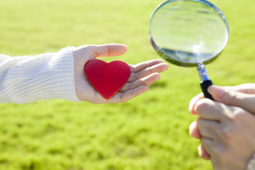 Women are expanding the heart through a magnifying glass