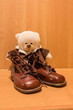 Leinwandbild Motiv Antike Kinderschuhe mit Teddybär