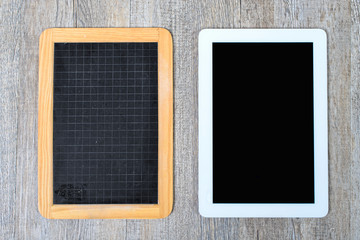 school blackboard and digital tablet