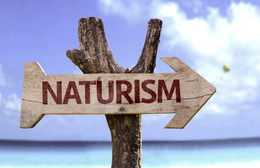 Naturalism wooden sign with a beach on background