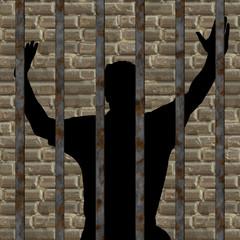silhouette of man in prison