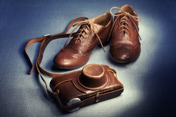 Brown brogues and camera case in studio