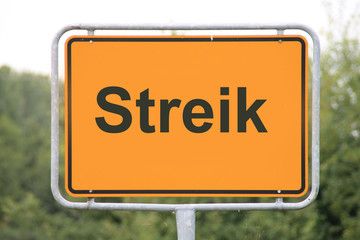 Ein Ortseingangsschild Streik