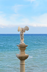 Statue of a woman in the background of the sea, Crimea