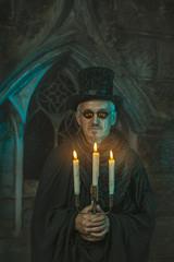 Evil sorcerer with a candelabra in hand.