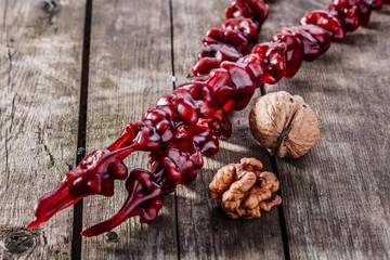 churchkhela walnut red on a wooden surface