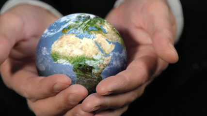 ROTATING CLOSE EARTH GLOBE IN HANDS