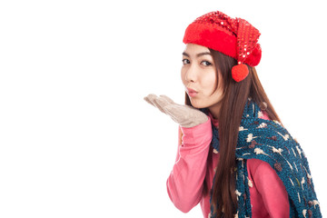 Asian girl with red christmas hat blowing a kiss