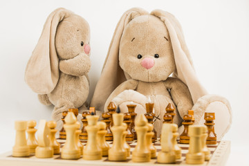 toy rabbits playing chess