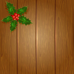 Wooden Christmas background with holly berry