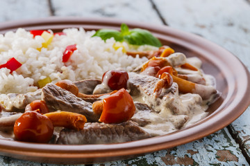 Beef stroganoff with mushrooms and rice