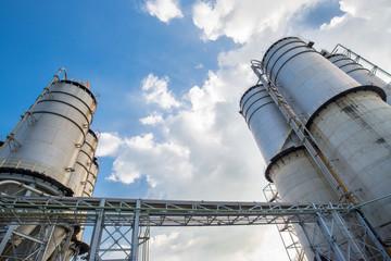 Large silos under blue sky