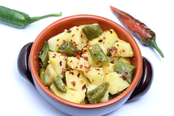 Bowl with potatoes and chili pepper