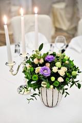 Floral arrangement on elegant dinner table