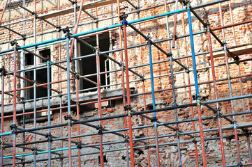 Scaffolding around brick facade
