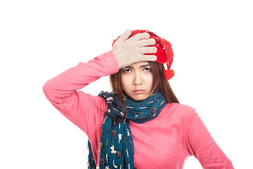 Asian girl with red christmas hat put palm on face