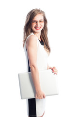 Happy business woman carrying a laptop.