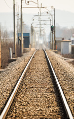 Railroad tracks go to horizon