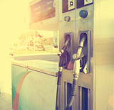 Petrol and gasoline nozzles at the fuel station poster