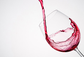 Wine pouring into a glass in diagonal composition