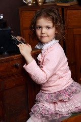 The little girl in vintage interior