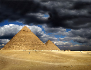Storm clouds and pyramids in Giza, Cairo, Egypt, UNESCO WH Site