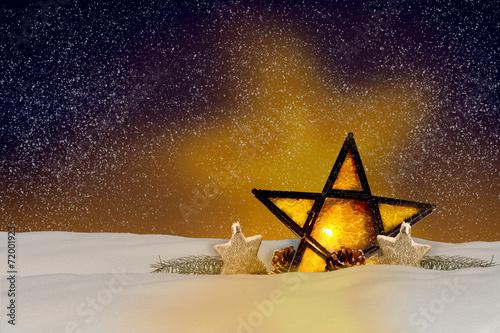 canvas print picture Leuchtender Weihnachtsstern bei Nacht