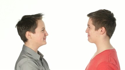 teenager brothers looking at each other