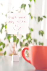 note on the table start your day with smile