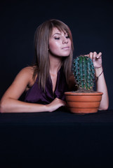Girl posing in studio with cactus