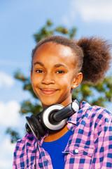 Portrait of happy African girl with headphones