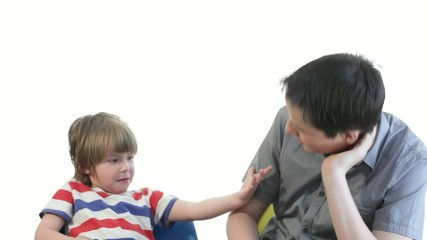 teenager boy counting with preschooler brother