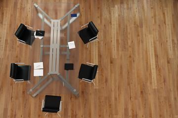 Tisch im Konferenzraum mit Stühlen von oben