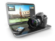 Photo camera, laptop and mobile phone. Journalist  or  traveler - 72004108