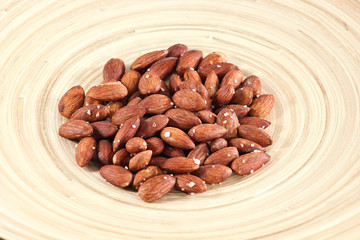 Salted Roasted Almonds Nuts on Wooden Surface