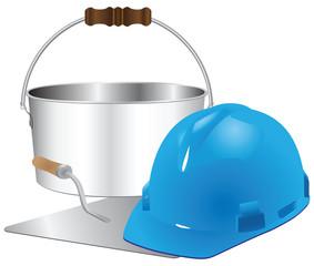 Helmet and trowel with bucket of cement