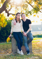 Young happy couple posing outdoor. Autumn scenery.