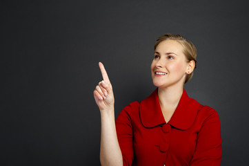 Businesswoman smile point finger to empty copy space, business w