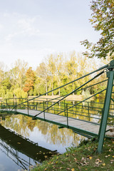 Bridge over lake in autumn