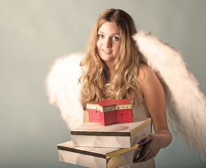 Merry Christmas: Beautiful angel with Christmas presents :)