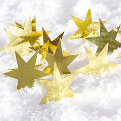 Magical background with golden stars and snowflakes