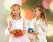Happy adorable little girls with gift box
