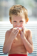 Little boy eating a sandwich
