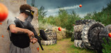 Paintball action scene in woodsball scenario poster