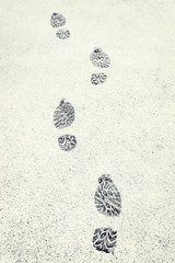 Human footprints in the fresh white snow