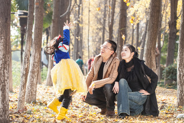 happy family togetherness portrait in forest, father,mother and