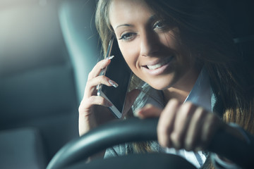Smiling driver woman in the phone