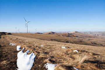 Turbines producing wind power on the grassland